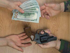 gun and money exchange